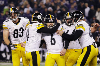 BALTIMORE, MD - DECEMBER 02: Kicker Shaun Suisham #6 of the Pittsburgh Steelers is mobbed by teammates after hitting the game winning field goal as time expired to give the Steelers a 23-20 win over the Baltimore Ravens at M&T Bank Stadium on December 2,