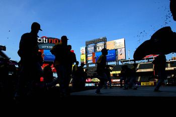 September 25, 2012; New York, NY, USA; Members of the Pittsburgh Pirates warm up before a game against the New York Mets at Citi Field. Mandatory Credit: Brad Penner-USA TODAY Sports