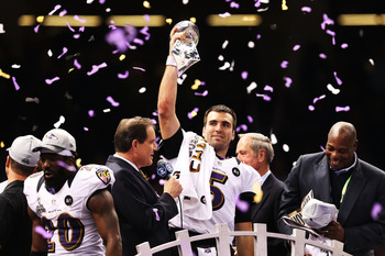 Joe Flacco hoists the Lombardi Trophy for the first time in his career.