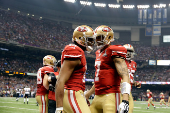 Colin Kaepernick celebrates his 15-yard rushing touchdown in the fourth quarter.