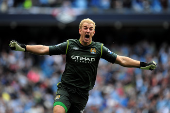 Joe Hart celebrating Man City's title.