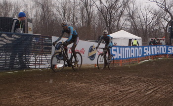 Sven Nys and Klaas Vantornout ride away from the field at the start of the bell lap.