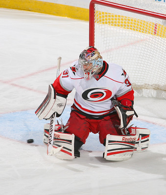 BUFFALO, NY - JANUARY 25: Dan Ellis #31 of the Carolina Hurricanes plays in goal against the Buffalo Sabres at First Niagara Center on January 25, 2013 in Buffalo, New York.Carolina won 3-1. (Photo by Rick Stewart/Getty Images)