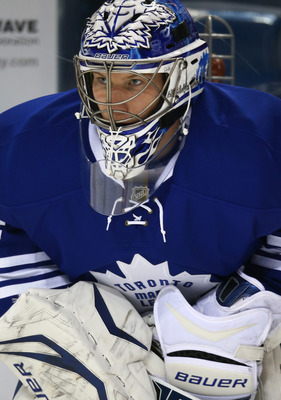 BUFFALO, NY - JANUARY 29: James Reimer #34 of the Toronto Maple Leafs warms up before their NHL game against the Buffalo Sabres at First Niagara Center on January 29, 2013 in Buffalo, New York. (Photo by Tom Szczerbowski/Getty Images)