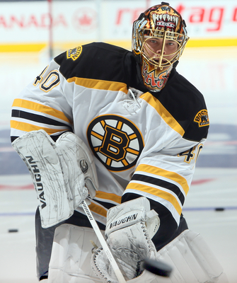 TORONTO, CANADA - FEBRUARY 2:  Tuukka Rask #40 of the Boston Bruins shoots during warmup before NHL action against the Toronto Maple Leafs at the Air Canada Centre February 2, 2013 in Toronto, Ontario, Canada.  (Photo by Abelimages/Getty Images)