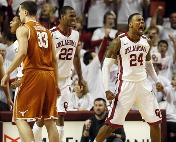 Oklahoma senior forwards Amath M'Baye (22) and Romero Osby (24).  (The Oklahoman, Nate Billings/Associated…)