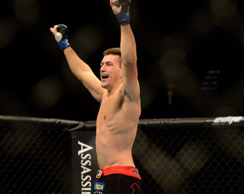 Jul. 7, 2012; Las Vegas, NV, USA; UFC fighter Demian Maia (left) celebrates his win over Dong Hyun Kim during a welterweigh bout in UFC 148 at the MGM Grand Garden Arena. Mandatory Credit: Mark J. Rebilas-USA TODAY Sports