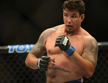 May 26, 2012; Las Vegas, NV, USA; Frank Mir prepares to throw a punch against Junior Dos Santos (not pictured) during UFC 146 at the MGM Grand Garden event center. Mandatory Credit: Ron Chenoy-USA TODAY Sports