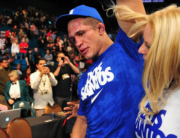 Dec 29, 2012; Las Vegas, NV, USA; Junior Dos Santos leaves the ring after being defeated by Cain Velasquez during UFC 155 at the MGM Grand Garden Arena. Mandatory Credit: Gary A. Vasquez-USA TODAY Sports