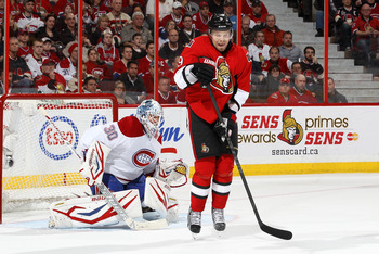 Montreal Canadiens Goalie Peter Budaj in front of Ottawa Senator Milan Michalek.