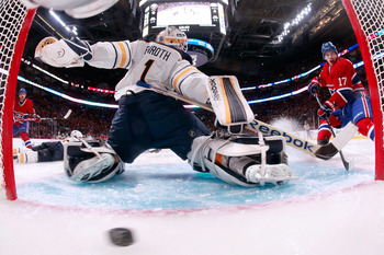 Buffalo Sabres goalie Jhonas Enroth lets one past him against Montreal.
