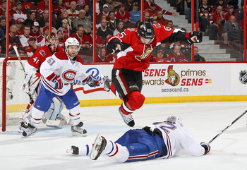 An Ottawa Senator literally jumps over a Montreal Canadien.