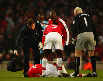 Abou Diaby in his customary crumpled position.