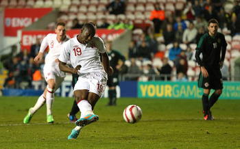 Benik Afobe in international action.