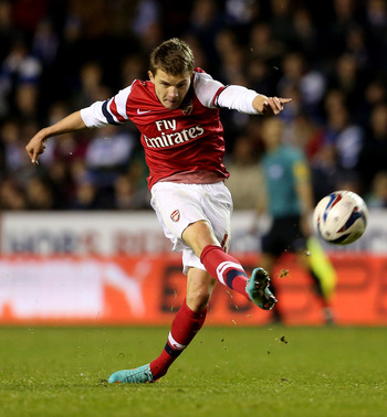 Thomas Eisfeld strikes the ball for Arsenal.