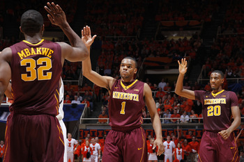 Trevor Mbakwe (left) and Andre Hollins (middle) led the Gophers past Michigan State on New Year's Eve.