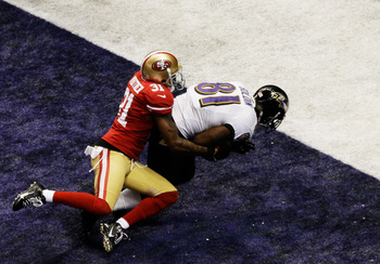 Donte Whitner is unable to stop Anquan Boldin's TD reception.