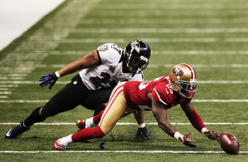 Tarell Brown strips Ray Rice and recovers the fumble.