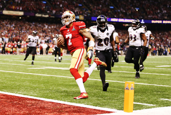 Colin Kaepernick scores on a 15-yard touchdown run.
