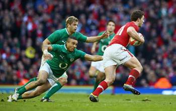 CARDIFF, WALES - FEBRUARY 02:  George North of Wales is challenged by Simon Zebo of Ireland during the RBS Six Nations match between Wales and Ireland at the Millennium Stadium on February 2, 2013 in Cardiff, Wales.  (Photo by Michael Steele/Getty Images)