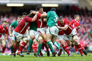 CARDIFF, WALES - FEBRUARY 02:  Mike Phillips of Wales is challenged by Mike Ross of Ireland during the RBS Six Nations match between Wales and Ireland at the Millennium Stadium on February 2, 2013 in Cardiff, Wales.  (Photo by Michael Steele/Getty Images)