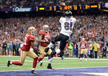 NEW ORLEANS, LA - FEBRUARY 03:  Anquan Boldin #81 of the Baltimore Ravens makes a 13-yard touchdown reception in the first quarter from Joe Flacco #5 against Donte Whitner #31 of the San Francisco 49ers during Super Bowl XLVII at the Mercedes-Benz Superdo