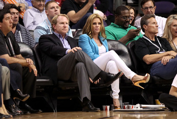 Suns owner Robert Sarver sits courtside.