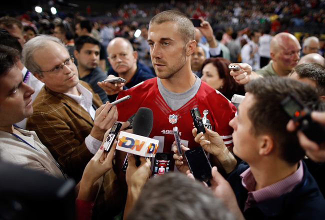 NEW ORLEANS, LA - JANUARY 29:  Alex Smith #11 of the San Francisco 49ers answers questions from the media during Super Bowl XLVII Media Day ahead of Super Bowl XLVII at the Mercedes-Benz Superdome on January 29, 2013 in New Orleans, Louisiana. The San Fra