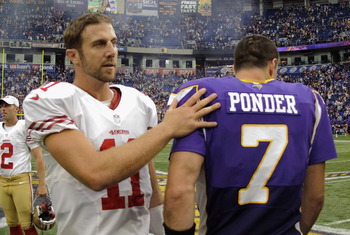Alex Smith and Christian Ponder congratulate eachother on a good game.