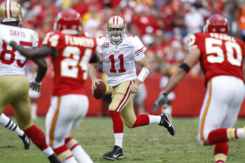 Alex Smith eludes KC's defenders