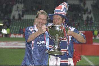Gascoigne celebrates the 1996-97 League Cup win with Ally McCoist.