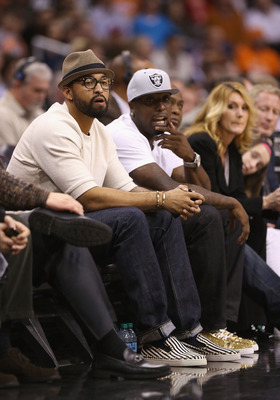 Matt Kemp enjoys the courtside view at a recent Clippers game.