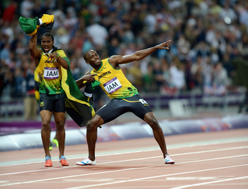 Usain Bolt strikes his famous pose after winning Olympic gold.