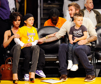 The Beckhams taking in a Lakers game courtside, a little closer than the average family of four gets to sit.