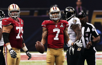 49ers quarterback Colin Kaepernick (center) expects to be better in 2013.  His raw talent and dual-threat capability should certainly benefit from Super Bowl experience.