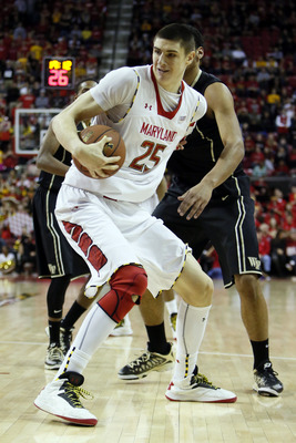 Feb 2, 2013; College Park, MD, USA; Maryland Terrapins center Alex Len (25) fights for the ball against the Wake Forest Demon Deacons at Comcast Center. Mandatory Credit: Mitch Stringer-USA TODAY Sports