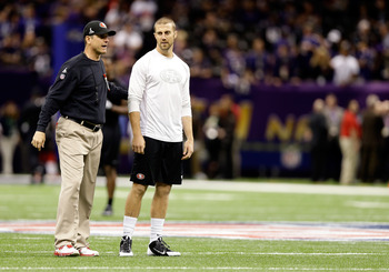NEW ORLEANS, LA - FEBRUARY 03:  Head coach Jim Harbaugh and Alex Smith #11 of the San Francisco 49ers walk on the field during warm ups prior to Super Bowl XLVII against the Baltimore Ravens at the Mercedes-Benz Superdome on February 3, 2013 in New Orlean