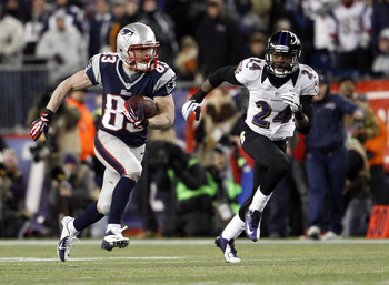 Jan 20, 2013; Foxboro, MA, USA; New England Patriots wide receiver Wes Welker (83) runs past Baltimore Ravens cornerback Corey Graham (24) during the fourth quarter of the AFC championship game at Gillette Stadium.   Mandatory Credit: David Butler II-USA