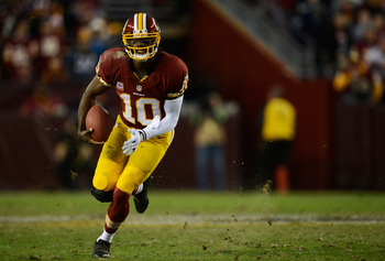 LANDOVER, MD - JANUARY 06:  Robert Griffin III #10 of the Washington Redskins runs the ball against the Seattle Seahawks during the NFC Wild Card Playoff Game at FedExField on January 6, 2013 in Landover, Maryland.  (Photo by Patrick McDermott/Getty Image