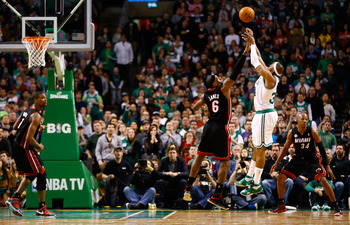 Paul Pierce shoots over the out-stretched arm of LeBron James in the Celtics' 100-98 victory over Miami.