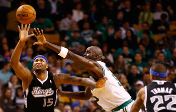 Kevin Garnett contests a pass against DeMarcus Cousins.