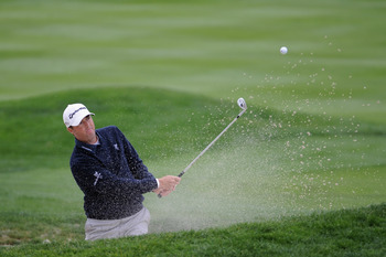 Ryan Palmer plays a shot from the sand at the 2012 AT&T Pro-Am. He finished tied for 20th.