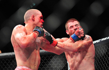 "Joe Lauzon and Jim Miller gave it their all in this ""Fight of the Night."""