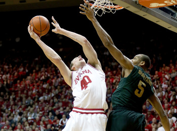 Adreian Payne attempts to alter Cody Zeller's shot.