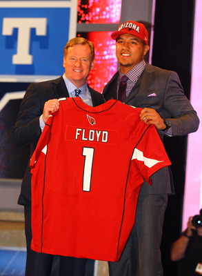 Who will be getting their picture with Roger Goddell when the Cardinals pick seventh?