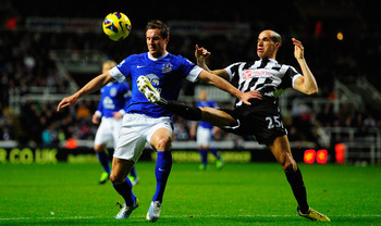 NEWCASTLE UPON TYNE, ENGLAND - JANUARY 02:  Everton player Phil Jagielka (l) is challenged by Gabriel Obertan during the Barclays Premier League match between Newcastle United and Everton at St James' Park on January 2, 2013 in Newcastle upon Tyne, Englan
