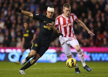 STOKE ON TRENT, ENGLAND - JANUARY 29:  Ryan Shawcross of Stoke City holds off a challenge from Franco Di Santo of Wigan Athletic during the Barclays Premier League match between Stoke City and Wigan Athletic at the Britannia Stadium on January 29, 2013 in