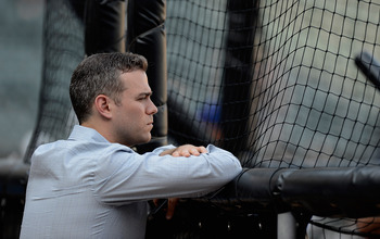 Cubs President of baseball operations, Theo Epstein, looks on during batting practice before the Cubs played the White Sox at U.S. Cellular Field.