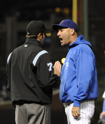 Cubs manager Dale Sveum argues a call with an umpire during a game against the Houston Astros.