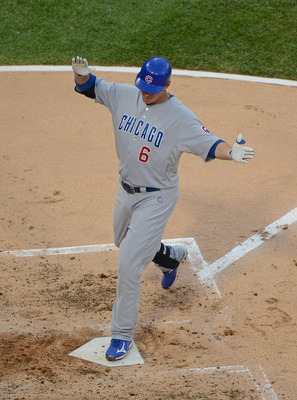 Chicago Cubs' Bryan LaHair crosses home plate in a game against the Chicago White Sox.